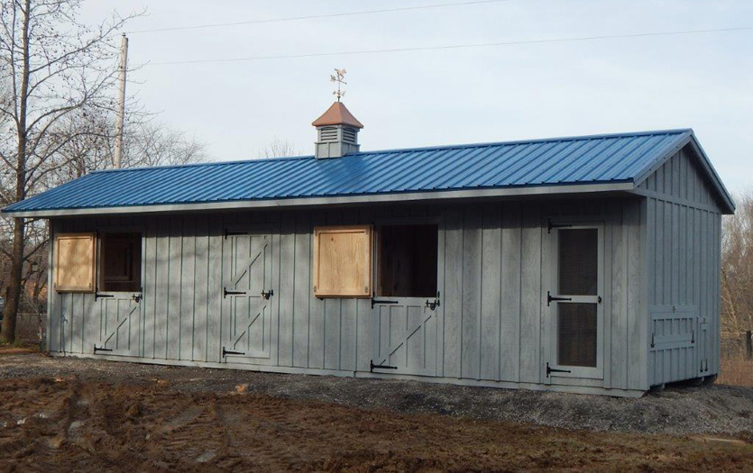10x38 barn- stain(gray birch) roof (gallery blue)