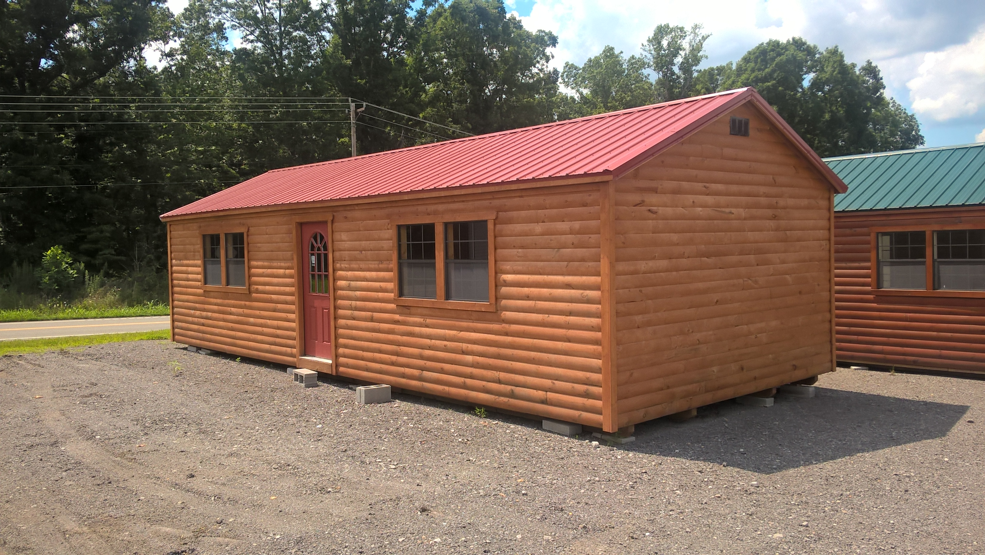 Small log cabins horse barns factory direct sheds for Log cabin garages for sale